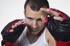 Kick boxer in defensing stand Royalty Free Stock Photography