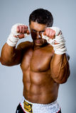 Kick-boxer in fighting stance. With his hands up Stock Photography