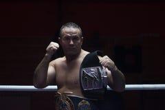 Kick boxer with his championship belt Stock Photo
