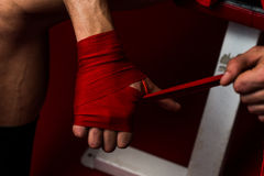 Kick Boxer Putting Straps On His Hands Stock Photos