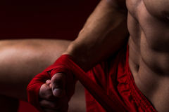 Kick Boxer Putting Straps On His Hands Royalty Free Stock Photography
