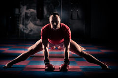 Kick boxer stretching exercise for the big fight.  Stock Photography