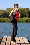Kick boxing woman. Kick boxing sporty female outdoors. Shot was taken with polarized filter royalty free stock images