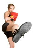 Kick Boxing Woman. Beautiful isolated kick boxing woman Stock Photography