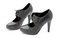Kick-heeled kvinnor skor. arkivfoton
