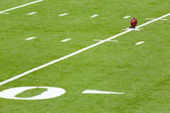 Kick off. Football on a kicking stand in the  football field Royalty Free Stock Photo