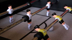 Kick off strike in table football game stock video footage