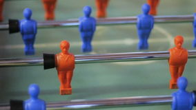 Kick off strike in table football game.The guys play table football. The man is playing football stock video footage