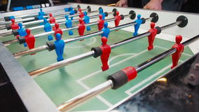 Kick off strike in table football game. Young people playing foosball. Side view.  stock video