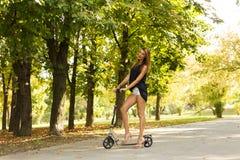 Kick scooter girl Stock Photos