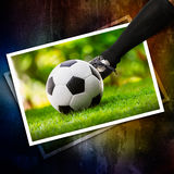 Kick the soccer ball in photo Stock Image
