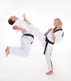Kick to head in close fight. Master show upper kick to head in close fight Royalty Free Stock Photography