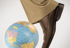 Kick the world. Business man kicking globe Royalty Free Stock Photos