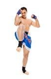 Kickbox fighter executing a kick Stock Photos