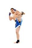Kickbox fighter executing a kick Stock Photo