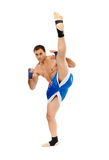 Kickbox fighter executing a kick Stock Photography
