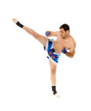 Kickbox fighter executing a kick Stock Photo