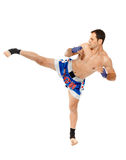 Kickbox fighter executing a kick Stock Photos