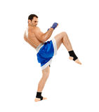 Kickbox fighter executing a kick Royalty Free Stock Photography