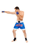 Kickbox fighter executing a punch Stock Photo