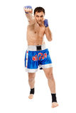 Kickbox fighter executing a punch Stock Photos