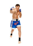 Kickbox fighter executing a punch Stock Photography