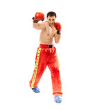 Kickbox fighter executing a punch Royalty Free Stock Images