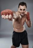 Kickbox fighter on gray background Royalty Free Stock Photos