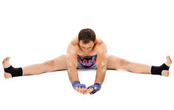 Kickbox fighter stretching Royalty Free Stock Photos