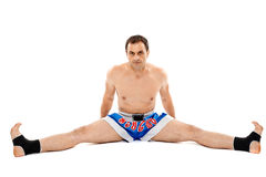 Kickbox fighter stretching Royalty Free Stock Photo