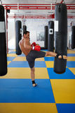 Kickbox fighter training with the punch bag Stock Photo