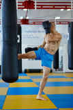 Kickbox fighter training with the punch bag Royalty Free Stock Photos
