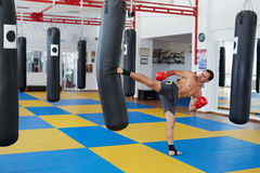 Kickbox fighter training with the punch bag Royalty Free Stock Images