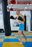 Kickbox fighter training with the punch bag Stock Images