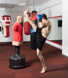 Kickbox fighter working with the dummy Royalty Free Stock Photography