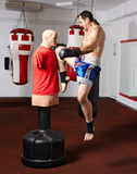 Kickbox fighter working with the dummy Royalty Free Stock Photos