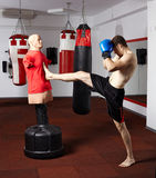 Kickbox fighter working with the dummy Stock Photos
