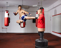 Kickbox fighter working with the dummy Royalty Free Stock Images