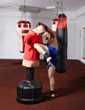 Kickbox fighter working with the dummy Royalty Free Stock Photo