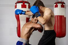 Kickbox fighters sparring in the gym Stock Photo