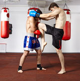 Kickbox fighters sparring in the gym Stock Photos