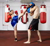 Kickbox fighters sparring in the gym Royalty Free Stock Photo