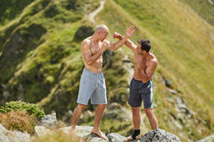 Kickbox fighters sparring in the mountains Royalty Free Stock Image