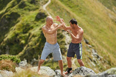Kickbox fighters sparring in the mountains Stock Images