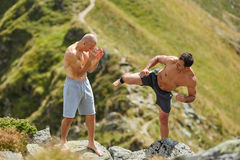 Kickbox fighters sparring in the mountains Stock Photography