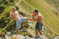 Kickbox fighters sparring in the mountains Stock Image