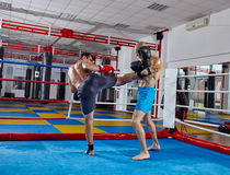 Kickbox fighters sparring in the ring Stock Photography