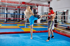 Kickbox fighters sparring in the ring Stock Images