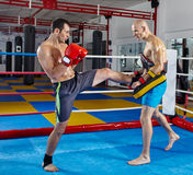Kickbox fighters training in the ring Stock Photos