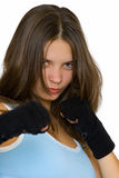 Kickbox girl. Portrait of a beautiful young girl posing as a kickbox fighter Royalty Free Stock Photo